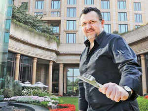 """""""You have to adapt to the new culture. It cannot be the opposite. It takes me no time. I am open-minded and so adapt easily,"""" says Christophe Gillino, 46, who works as the executive chef with the Leela Palace in Delhi."""