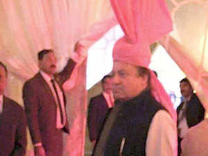 Pakistan's PM Nawaz Sharif today wore the pink turban gifted to him by his Indian counterpart Narendra Modi for his granddaughter's wedding.