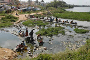 The Madiwala lake, which has become a home for washermen, has been turning dirty with soap water and other detergent chemicals getting mixed. (TOI photo: S Shiv Kumar)