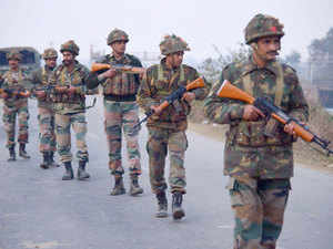 Pathankot attack was anticipated by the security establishment and local shopkeepers had been cautioned about it well in advance.  In pic: Indian Army personnel patrol near the Air Force Base in Pathankot.