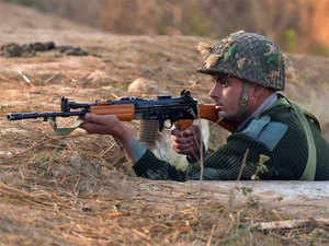 (In pic) A soldier takes up position at an airforce base in Pathankot, during an operation to 'sanitise' the base following an attack by gunmen.