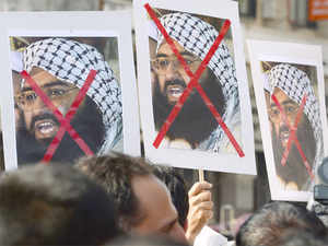 Activists carry placards of the chief of Jaish-e-Mohammad, Maulana Masood Azhar during a protest against the attack on the air force base in Pathankot.