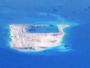 China landed two more civilian planes on an artificial island it has built in a contested part of the strategic South China Sea, days after its first successful landing on the island that drew worldwide condemnation.