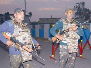 Indian air force personnel stand guard at the base in Pathankot.