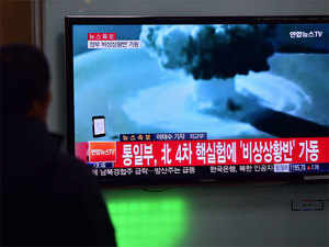 (In pic) People watch a news report on North Korea's first hydrogen bomb test at a railroad station in Seoul.