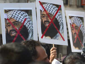 Indian activists carry placards of the chief of Jaish-e-Mohammad, Maulana Masood Azhar during a protest against the attack on the air force base in Pathankot, in Mumbai.