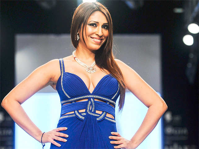Pooja Misrra, who was recently banned from entering her own apartment in Mumbai, says her image is being maligned because she is single.