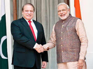 In pic: Prime Minister Narendra Modi shakes hand with his Pakistani counterpart Nawaz Sharif before their meeting in New Delhi on May 23,2014.