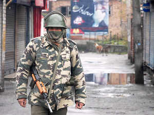 Paramilitary soldier stand guard during restrictions in Srinagar.