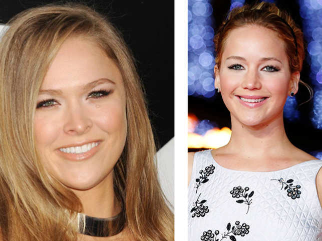 Martial artist-actress Ronda Rousey says she is 'looking for an excuse to hang with Jennifer Lawrence'.