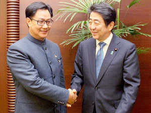 Union Minister Kiren Rijiju shakes hands with Japanese Prime Minister Shinzo Abe at a banquet hosted by the latter for the participants of the the symposium on 'Shared Values and Democracy in Asia', in Tokyo.