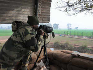 In pic: A Border Security Force (BSF) soldier keeps a watch at the border fence at Bamial border in Pathankot.