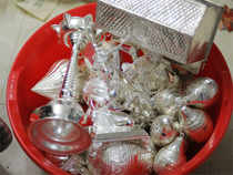 Taking weak cues from overseas markets, silver prices dropped by Rs 272 to Rs 34,417 per kg in futures trade.
