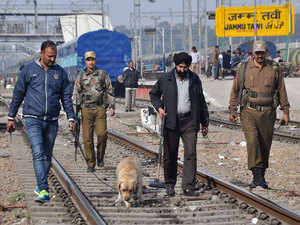 In pic: Indian police officials walk along railway tracks at a station in Jammu on January 3, 2016, after security was increased on railways in northern India as after Pathankot attack.