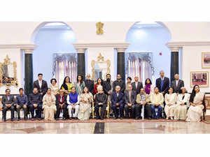 President Pranab Mukherjee poses for a photo with dignitaries during a lunch hosted for 100 women achievers at Rashtrapati Bhavan.