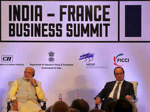 """Addressing India-France Business Summit, Modi said the French President """"is correct"""" in saying that terrorism is a challenge just like global warming."""