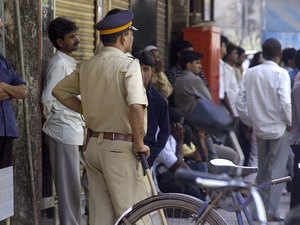 File photo:Police keep vigil near Danish Parkar's residence who was apparantly Dawood Ibrahim's nephew, killed in brutal accident on Mumbai-Goa highway on April 27,2006.