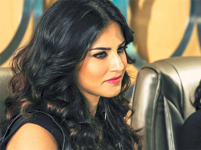 Going by her onscreen persona Sunny Leone comes across as a bold and outgoing woman in real life but the actress says she is just the opposite.