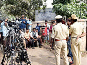 The pan-India Islamic State (IS) module busted by NIA was using a messenger application 'Trillian' for communication.  In pic: Media waits at the entrance of the FSL where NIA intterogated the detained suspected Islamic State sympathisers.