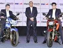 TVS Motor Company Chairman Venu Srinivasan, K N Radhakrishnan, President and CEO, TVS Motor Company and Sudarshan Venu, Joint Managing Director, TVS Motor Company at the launch of TVS Apache RTR 200 and TVS Victor.
