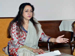 """Allotment of a prime piece of land to actress and BJP MP Hema Malini allegedly at a """"throwaway price"""" by Maharashtra government today kicked up a storm ."""