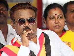 Madras High Court today directed police to inquire into a complaint against DMDK leader Vijayakanth for allegdly spitting at journalists at a press meet