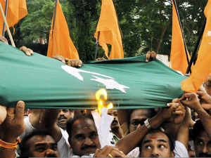 """Shiv Sena today said that by arresting a fan of Indian cricketer Virat Kohli for hoisting Indian tricolour atop his home while terrorists are """"roaming free"""" on Pakistan's soil"""