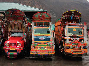 Every morning, around 20 brightly coloured, hand-painted trucks from Muzaffarabad in Pakistan start crossing Kaman Aman Setu.