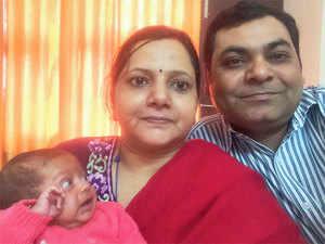 Sanjay Agarwal, with his wife Sonali and son Namandev