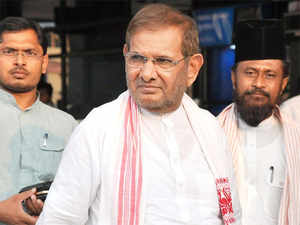 """Making the announcement, JD(U) chief Sharad Yadav said doors were open for the formation of a grand alliance in the state for which """"talks were on""""."""