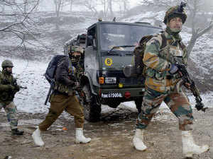 In pic: Army personnel arrive to take positions outside the house where Commander of LeT militant Abu Usama, was holed up during an encounter at Lolab in Kupwara.