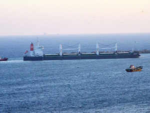 A commercial heads into the Visakhapatnam Port channel in Visakhapatnam.