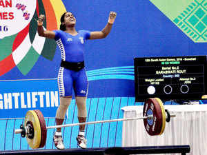 Weightlifter Saraswati Rout of India reacts after winning gold in 58 kg category in the 12th South Asian Games.