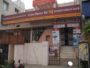 Punjab National Bank and Dena Bank are inching closer to the regulatory restriction of lending, opening new branches or even recruiting as it bad loans has risen to 10 per cent of the total loans.