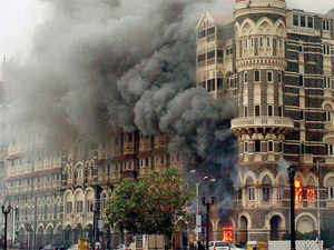 In pic: Smoke is seen billowing out of the ground and first floor of the Taj Hotel in south Mumbai during security personnel's 'Operation Cyclone' following the 26/11 terror attacks in 2008.