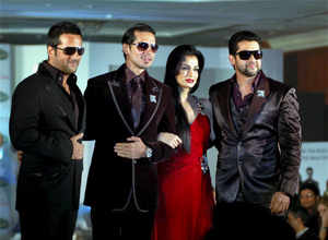 Actors Fardeen Khan, Dino Morea, Diya Mirza and Aftab Shivdasani walk the ramp during a fashion show that brought together the cast of Sanjay Gupta's film Acid Factory. PTI