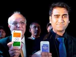 Mohit Goel, right, Director of Ringing Bells Pvt. Ltd., and Ashok Chadha, left, spokesperson, show a Freedom 251 smartphone, which is to be priced at Rs 251 or $3.6 approximately, during its release.