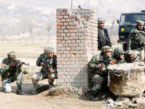 Three army commandos, including two Captains, and a militant were killed today in the fierce gunfight with a group of terrorists holed up inside a government building on the outskirts of Srinagar.