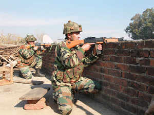 In pic: Indian army soldiers take positions on a rooftop of a building outside the Indian airbase in Pathankot.