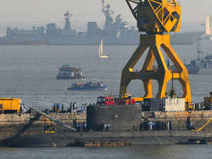 Indian navy sailors look into the Indian Naval Submarine Sindhuratna berthed in naval dockyard after a fire broke out in the submarine.
