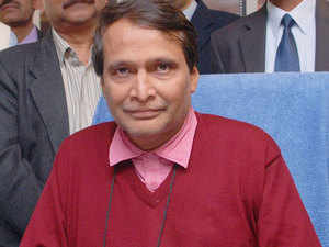 """Suresh Prabhu launched the """"Clean my Coach"""" service on Friday whereby a passenger can request for a dirty coach to be swept and cleaned by sending a SMS."""