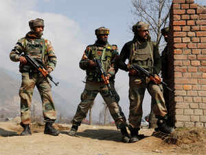 In pic: Army soldiers take position in Pampore