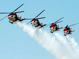 Indian Air Force's Advanced Light Helicopter (ALH) Sarang team displays a formation in Jamnagar