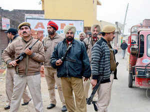 Police teams were rushed to a village in Kutch district bordering Pakistan after satellite phone signals were traced there by security agencies, police said today.
