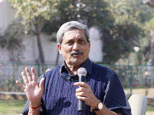 Manohar Parrikar arrived in Shanghai on his first visit to China to shore up defence ties amid strains in bilateral relations over Beijing's move to block India's attempts in the UN to ban Masood Azhar.