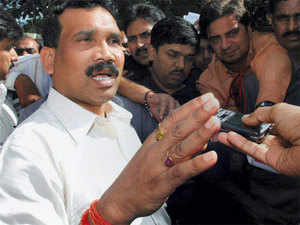CM of Jharkhand, Madhu Koda interacts with media persons infront of Birsa Munda Airport in Ranchi on August 23, 2008. (PTI)