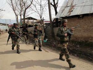 Pakistani troops fired 4-5 rounds on a forward post in Samba sector early this morning, a senior BSF officer said.In pic: Army personnel walking towards encounter site in Kashmir's Hajin area