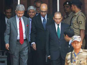 Foreign secretary Subramanyam Jaishankar, left, and Pakistan's foreign secretary Aizaz Ahmad Chaudhry, center right, exit a meeting in New Delhi.