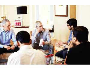 Apple COO Jeff Williams and CEO Tim Cook interact with startup founders in Mumbai.