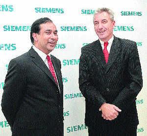Siemens CFO Sunil Mathur with managing director Armin Bruck